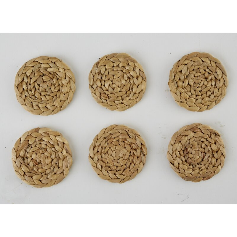 Six water hyacinth woven coasters on a white background