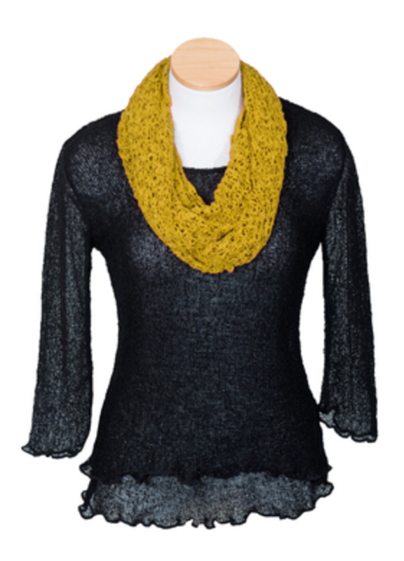 A mannequin bust with a black long sleeve top, and a mustard colored crochet infinity scarf.