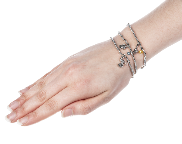 Hand and wrist showcasing three Little Wish bracelets