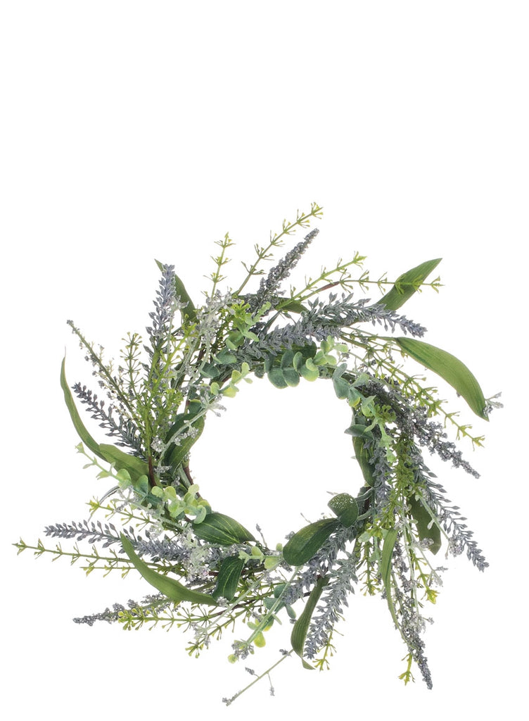 Lavender and spring greens artificial floral candle ring on white background.