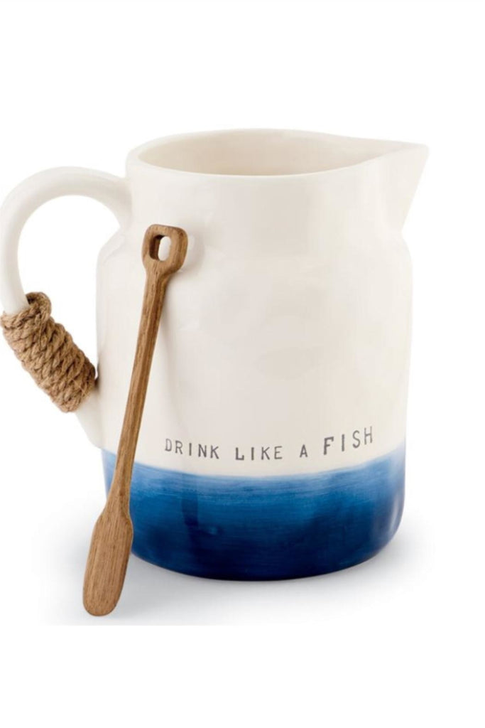 Hand-painted ceramic pitcher features debossed sentiment 'Drink like a FISH', wrapped jute rope handle and arrives tied with wooden stirring spoon.