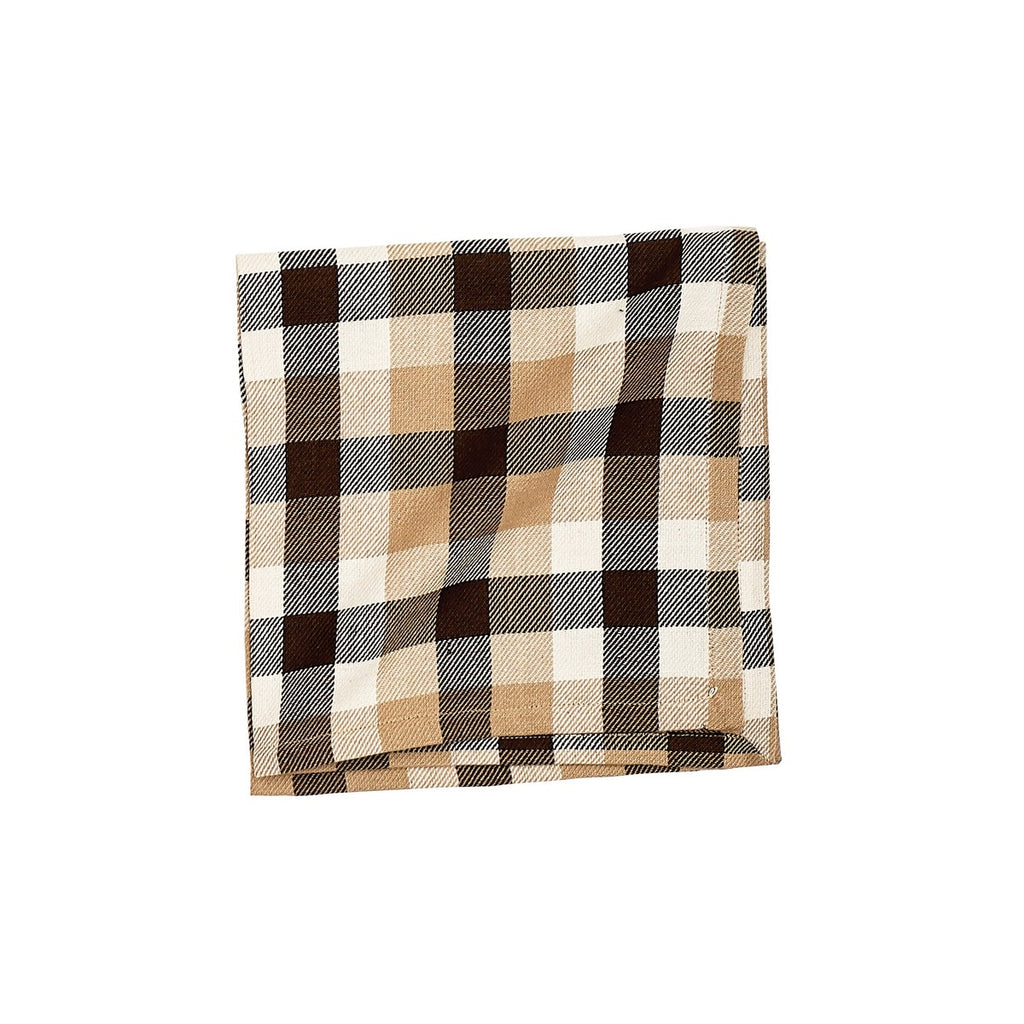 Plaid folded napkin with white, tan and chocolate brown.