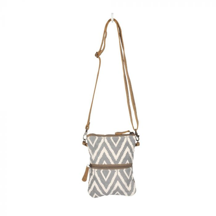 Rectangular cross body bag with a gray and off white diamond pattern, and features a horizontal zipper halfway down.  The bag is suspended by its thin brown strap from a white hook.