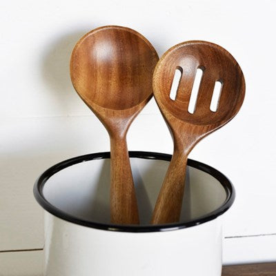 2 wooden spoon set.  Spoons are in a white canister with a black rim, handle down.