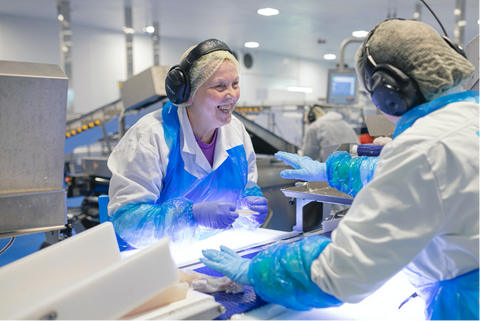 Factory workers inspect just-caught sushi-grade Aurora Salmon from Lerøy in Norway.