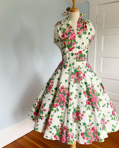 "1950s Quintessential Polished Cotton Sundress with Tie Neckline in Vibrant ""Busy Lizzies"" Floral Print"