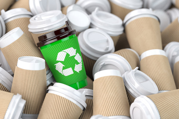 Littorary - green cup with recycling symbol in cluster of other cups