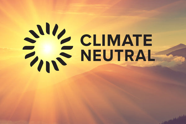 Littorary - Climate Neutral Logo Over Mountain Sunset