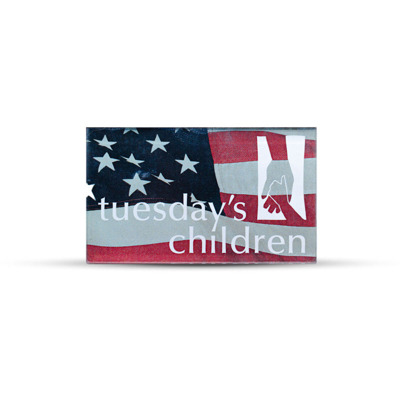 Rectangular magnet is imprinted with Tuesday's Children logo in white overlaid on a muted image of the American flag.