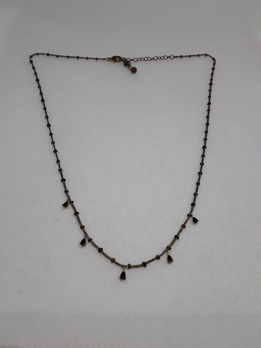 Brasstone necklace with black teardrop beads