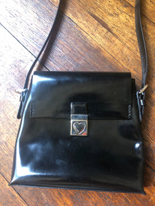 1990's | Moschino | Black Patent Leather Bag With Silver Heart Closure