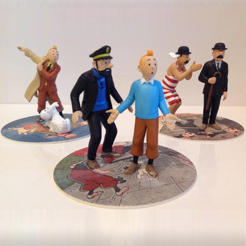 Tintin figures on coasters