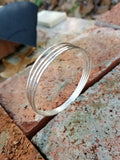 Four Ring Silver Bangle Bracelet