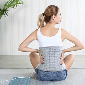 woman with Electric Heat Pad for Back Pain