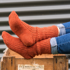 picture of feet leaning on a wooden crate wearing Humphrey Law alpaca/wool blend socks