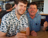 Photo of two men wearing bamboo fabric shirts. One is Paradise Palm print, the other is Bush Possum print. Available to purchase from Stewart's Menswear, Mullumbimby