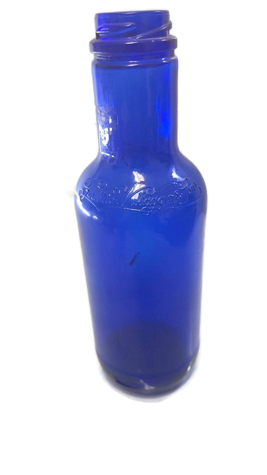 Ferolito Vultaggio & Sons Cobalt Blue Twenty Ounce Embossed Glass Bottle