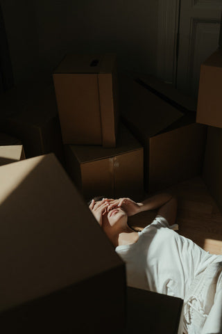 Depressed-woman-laying-on-floor