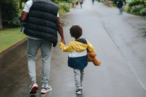 father-and-son-holding-hands-walking