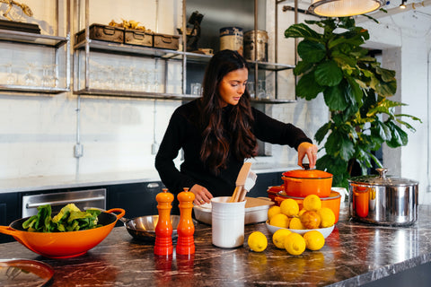 Woman in the kitchen surrounded by healthy foods. When it comes to self-care and self-love surrounding yourself and eating well is key