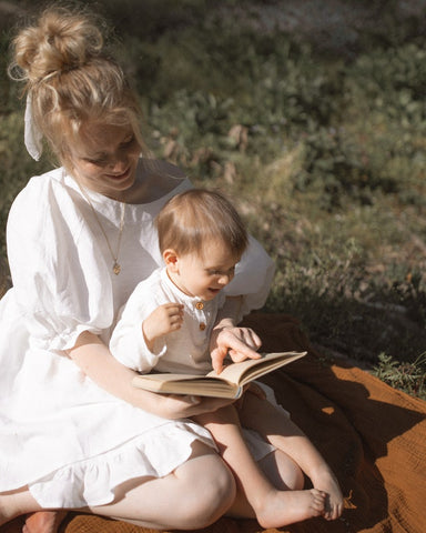 mother-and-son-reading-in-park