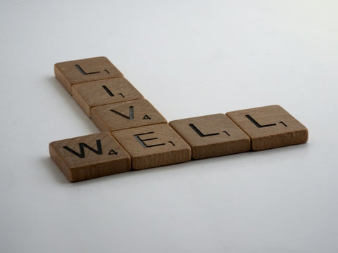 Live Well, spelt out in scrabble pieces.
