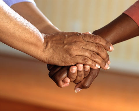 Hands reaching out to each other in support