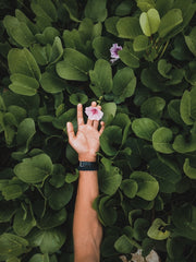 woman reaching for flower personal growth