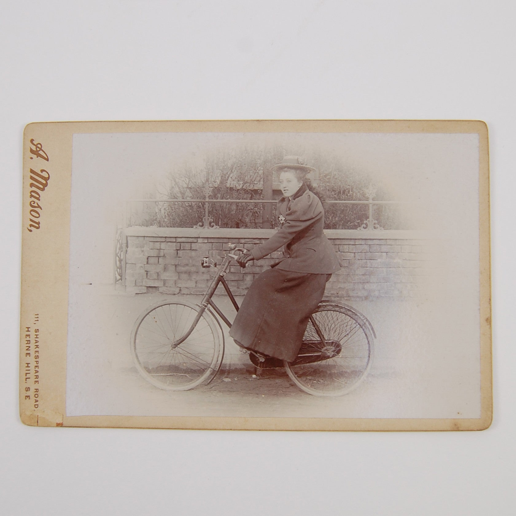 Mason, A. | Cabinet card depicting a female cyclist.