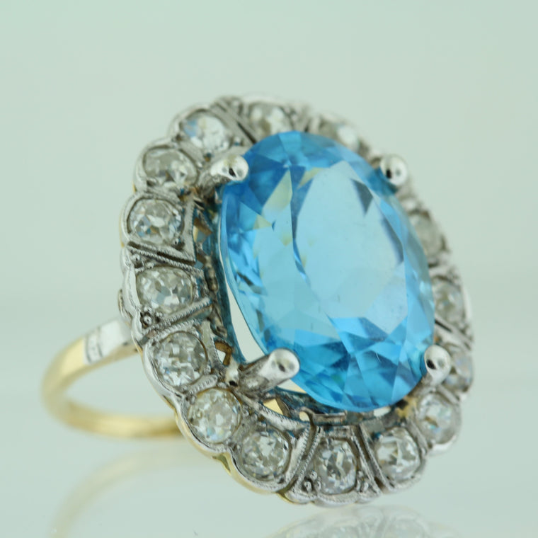 18k Yellow Gold Oval Blue Topaz (15.00ct) with Diamond (1.50ct) Halo Ring