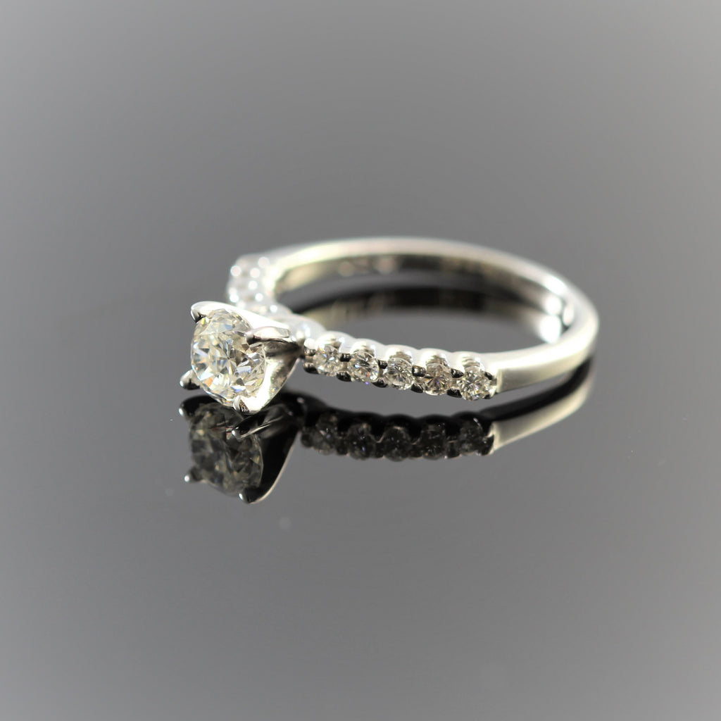 14k White Gold Round Diamond (.64ct) With Side Round Diamonds (.25) On Shank Engagement Ring