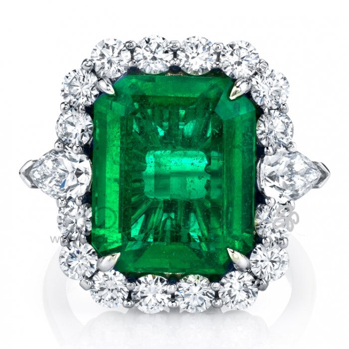 Emerald (8.59ct) With Oval Diamond (1.41) Side Stones & Diamond (.88ct) Halo Platinum Ring