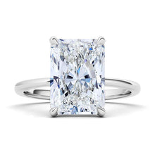 Load image into Gallery viewer, Emerald cut engagement ring. 14K white gold. The beauty of this solitaire is in its simplicity. This glistening diamond is graded VS+ for quality and F+ for color. With its sturdy design and clean lines, this timeless ring will be beautiful for a lifetime. Crafted with 0.35 ct.t.w. of high quality lab-grown diamonds. Purchases come with complimentary elegant jewelry gift box packaging