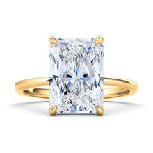 Load image into Gallery viewer, Emerald cut engagement ring. 14K yellow gold. The beauty of this solitaire is in its simplicity. This glistening diamond is graded VS+ for quality and F+ for color. With its sturdy design and clean lines, this timeless ring will be beautiful for a lifetime. Crafted with 0.35 ct.t.w. of high quality lab-grown diamonds. Purchases come with complimentary elegant jewelry gift box packaging