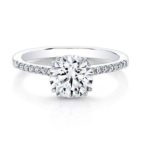 This round brilliant cut eight prong diamond solitaire engagement ring features diamond center stone in a six-prong setting. These diamonds are graded SI+ for quality and F+ for color.