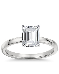 Make a royal proposal to your bride with this delicate diamond engagement ring. Expertly crafted in sleek 14K gold, this ring features a dazzling 0.35 ct.t.w. emerald-cut diamond solitaire with a color rank of F+ and clarity of SI+. Polished to a bright shine, this regal look is a special signature of your romance.