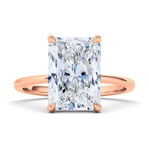 Emerald cut engagement ring. 14K rose gold. The beauty of this solitaire is in its simplicity. This glistening diamond is graded VS+ for quality and F+ for color. With its sturdy design and clean lines, this timeless ring will be beautiful for a lifetime. Crafted with 0.35 ct.t.w. of high quality lab-grown diamonds.  Purchases come with complimentary elegant jewelry gift box packaging