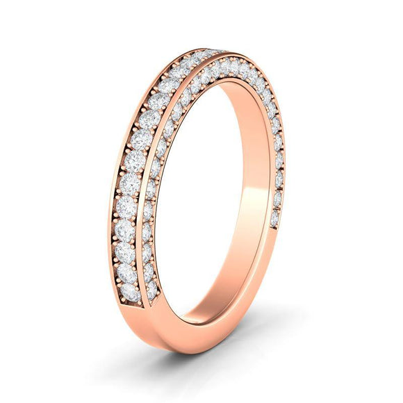3 sided wedding band features 3 lines of round  diamonds crafted in sleek 14k (rose gold, white gold, and yellow gold), halfway around the band. This modern design features a 0.77 ct.t.w. in the channel setting. The exceptional craftsmanship ensures that every diamond pieces is color F+ with clarity SI+, and all jewelry pieces will last for generations.