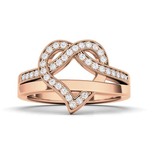 This is the perfect everyday ring for any diamond jewelry lover. The ring is made from high-quality 14K gold for a long-lasting shiny finish. Lined with round white diamonds of F+ color and SI+ clarity. The smooth curves form a heart shape at the center of the ring which create a different shine and texture to the fashion ring, giving it a bit more character. A thin band finishes the back of the ring, providing an easy fit for everyday wear.