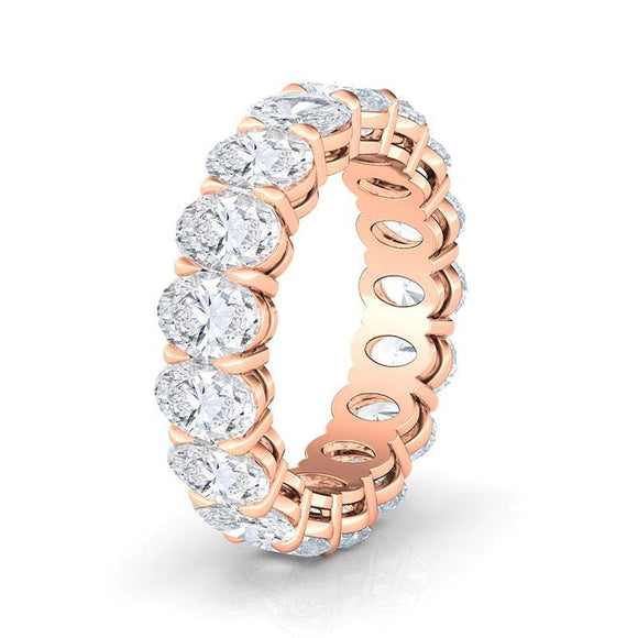 An elegant reinterpretation of a classic, this 14k gold eternity band features a bright row of sparkling oval diamonds all the way around the ring. These diamonds are graded SI+ for quality and F+ for color. The oval diamonds are held in place by shared prongs allowing the most area of the diamonds to be exposed while still holding them securely. The minimum weight of each diamond is 0.2ct.