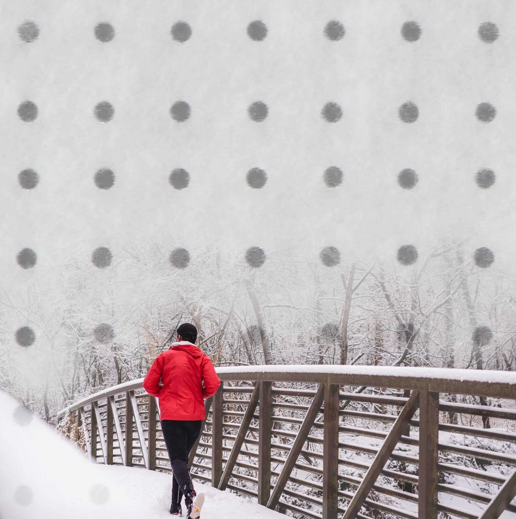 Vivo Performance: Teknica breathable insulation with holes man wearing red jacket running in snow
