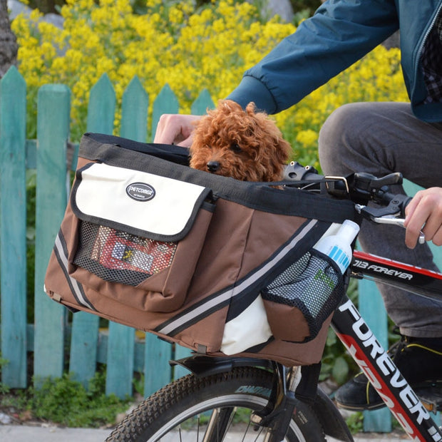 Portable dog bicycle carrier bag on a bike with dog in basket