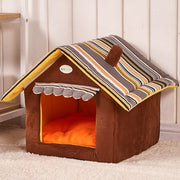 Brown dog house bed with striped roof