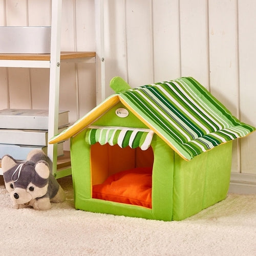 Green dog house bed with green and white striped roof