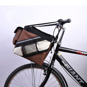 Brown and white Portable dog bicycle carrier bag on a bike