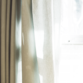 4 Ways to Keep Your Pleated Curtains From Seeming Dated article image