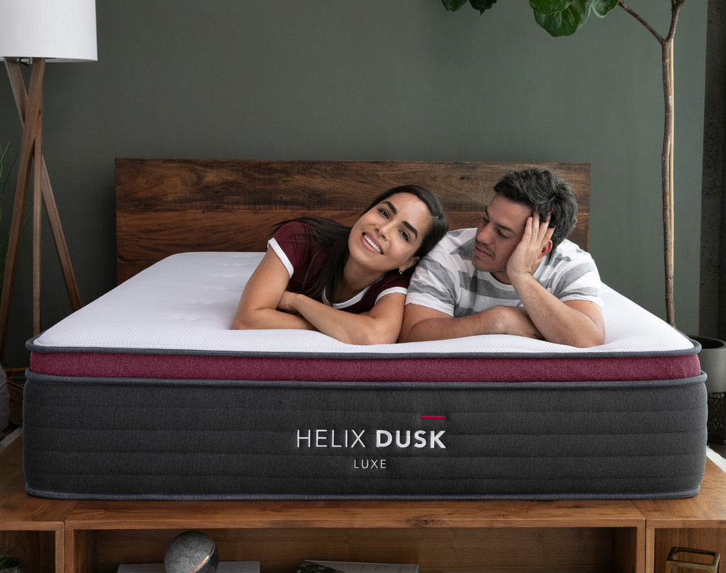 A couple enjoying the Helix Dusk Luxe Mattress