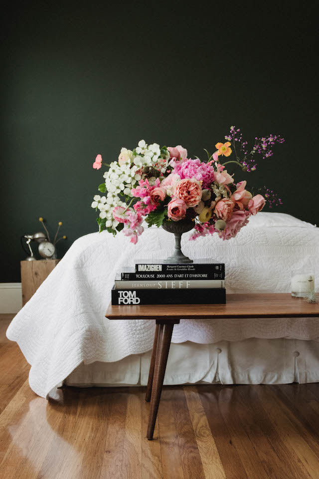 Pink and white flowers in a guest bedroom