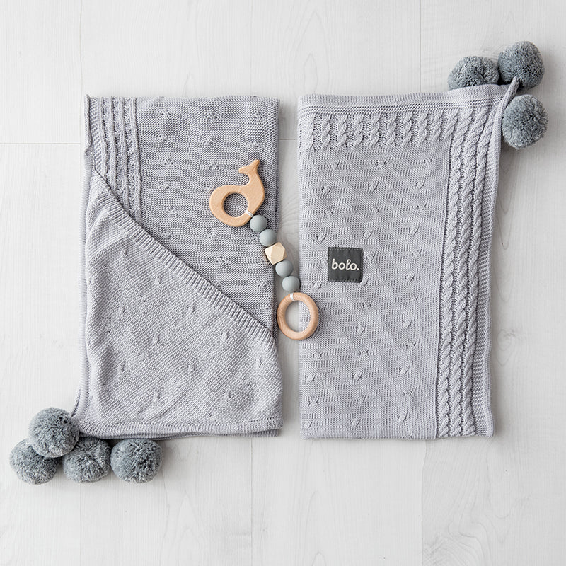 Cotton hooded blanket with pom poms - grey