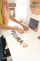 Kathy packaging a name bunting